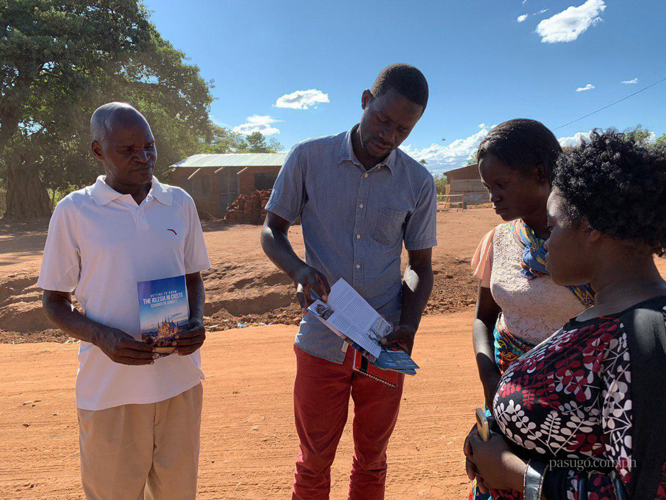 Brethren in Lilongwe, Malawi give out pamphlets to share their faith